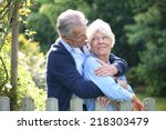 senior couple standing by fence ... | Shutterstock . vector #218303479