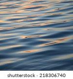 Water Surface At Dusk.