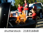 Small photo of Tailgate: Charcoal Burning In Grill During Tailgating Party