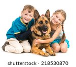 Stock photo happy children with a shepherd dog isolated on a white background 218530870