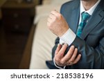 hands of the young man clasping ... | Shutterstock . vector #218538196