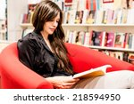 young woman reading books in a... | Shutterstock . vector #218594950