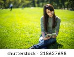 young asian woman in a park... | Shutterstock . vector #218627698