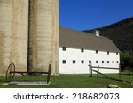 Cement Silos And A White Barn...