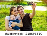 family with baby in park taking ... | Shutterstock . vector #218698510