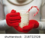 woman holds a winter cup close... | Shutterstock . vector #218722528