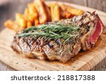 grilled beefsteak with french... | Shutterstock . vector #218817388