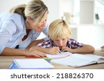 mom helping little boy to do... | Shutterstock . vector #218826370