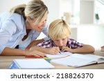 mom helping little boy to do... | Shutterstock . vector #218826370
