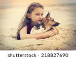Stock photo child hugging a cat and dog 218827690