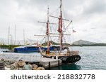 A Black Two Masted Schooner An...