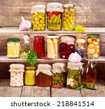 Canned Food On Wooden Background