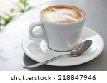 white cup of cappuccino stands... | Shutterstock . vector #218847946