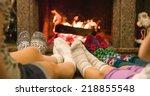 feet in woolen socks warming by ... | Shutterstock . vector #218855548