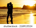 Silhouette Of A Couple On The...