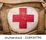 medical aid symbol on a vintage jute army bag