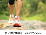 Stock photo young fitness woman legs walking on forest trail 218997220