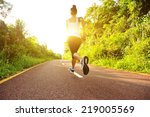 young fitness woman running at... | Shutterstock . vector #219005569