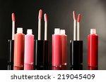 beautiful lip glosses on dark... | Shutterstock . vector #219045409