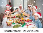 family in santas hats toasting... | Shutterstock . vector #219046228