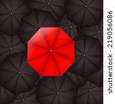 red umbrella against black... | Shutterstock .eps vector #219056086