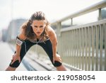 portrait of tired fitness young ... | Shutterstock . vector #219058054
