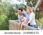 Family Enjoying Vacation In Log ...