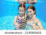 Happy Active Kids Swim In Pool...