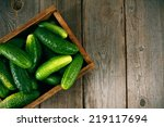 Cucumbers In A Box On A Wooden...