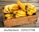 Bananas In A Box On A Wooden...