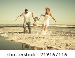 happy family playing on the... | Shutterstock . vector #219167116