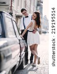 ouple by the old car. | Shutterstock . vector #219195514