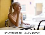 pensive young woman at cafe...   Shutterstock . vector #219210904