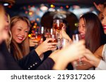 Stock photo beautiful women clinking glasses in limousine focus on glasses 219317206