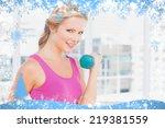 pretty blonde lifting dumbbells ... | Shutterstock . vector #219381559