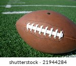 football laces on hash marks of turf playing field - stock photo