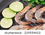 raw shrimps on pan with lemon.... | Shutterstock . vector #219554413