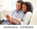 young couple sitting on sofa... | Shutterstock . vector #219582628