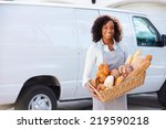 female baker delivering bread... | Shutterstock . vector #219590218