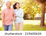 senior asian couple walking... | Shutterstock . vector #219600634