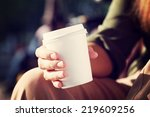 young woman drinking coffee... | Shutterstock . vector #219609256