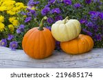 Trio Of Mini Pumpkins On Old...
