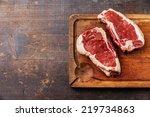 Raw fresh meat Ribeye Steak on dark background