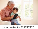 grandfather and grandson using... | Shutterstock . vector #219747190
