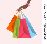 hand holding colorful shopping... | Shutterstock .eps vector #219776290