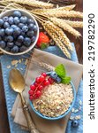 rolled oats in a blue bowl on a ... | Shutterstock . vector #219782290