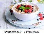 tasty oatmeal with berries on... | Shutterstock . vector #219814039