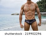 strong muscular fit man posing... | Shutterstock . vector #219902296