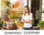 portrait of smiling florist... | Shutterstock . vector #219909484