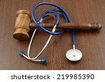 Gavel And Stethoscope On Woode...